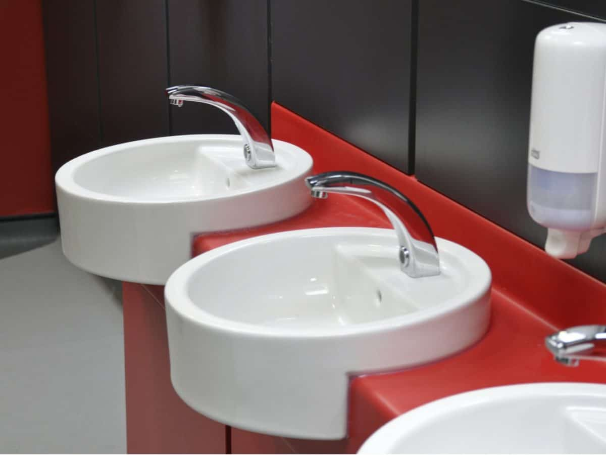 red vanity units and hand wash basins