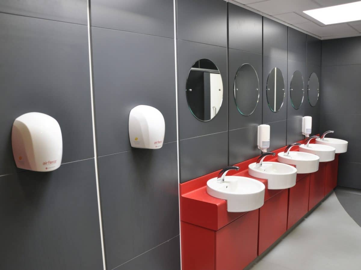 grey duct panels and red vanity unit in college washroom