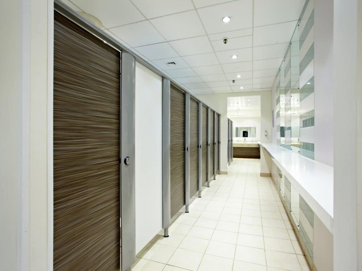 jarrolds high end retail washroom with wood grain cubicle doors