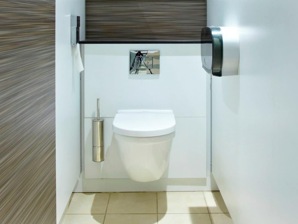 inside a high end toilet cubicle with wood grain panels