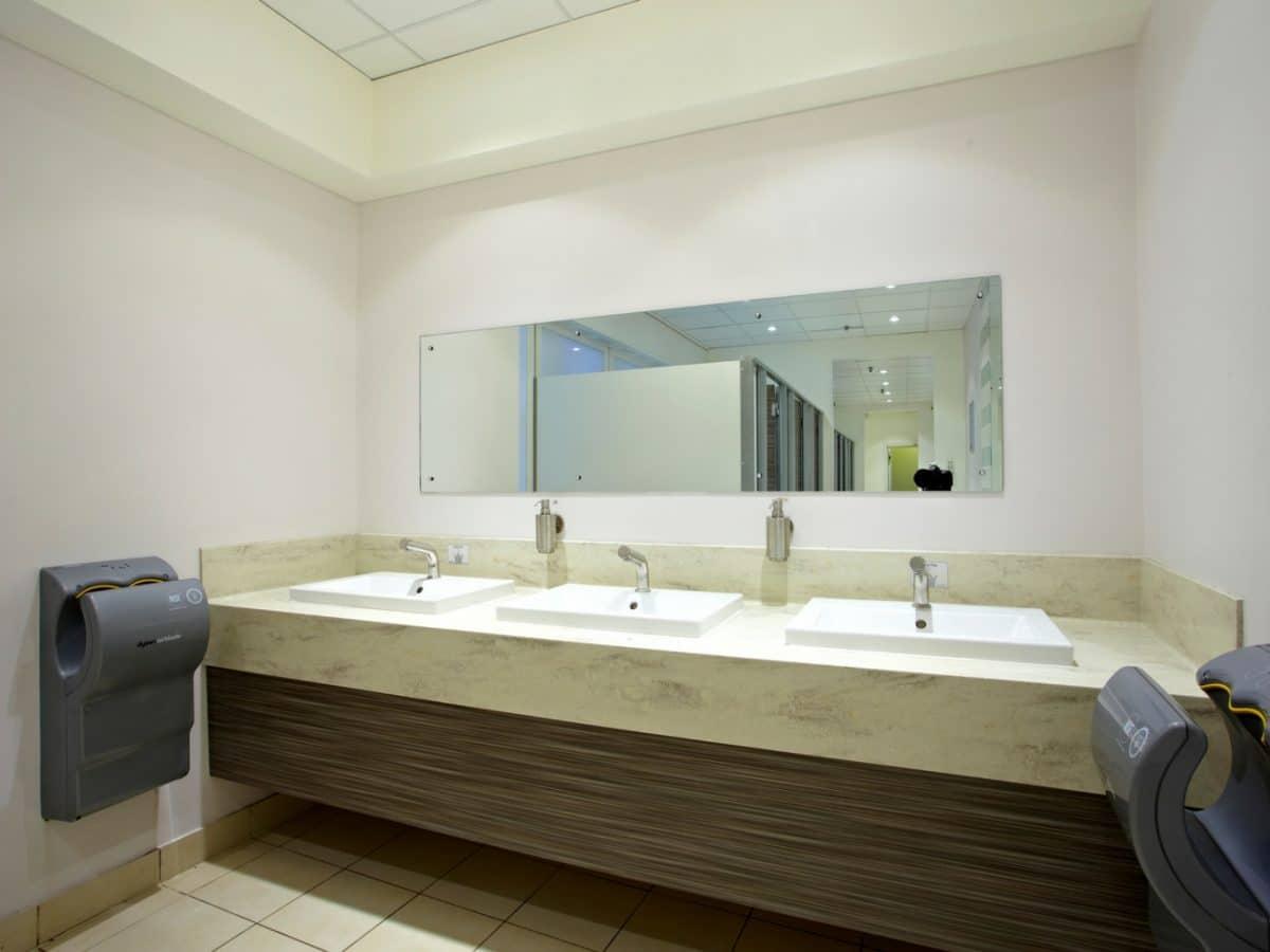 stone hand wash area with wood grain panels