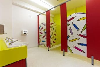 primary school toilet cubicles with graphic print
