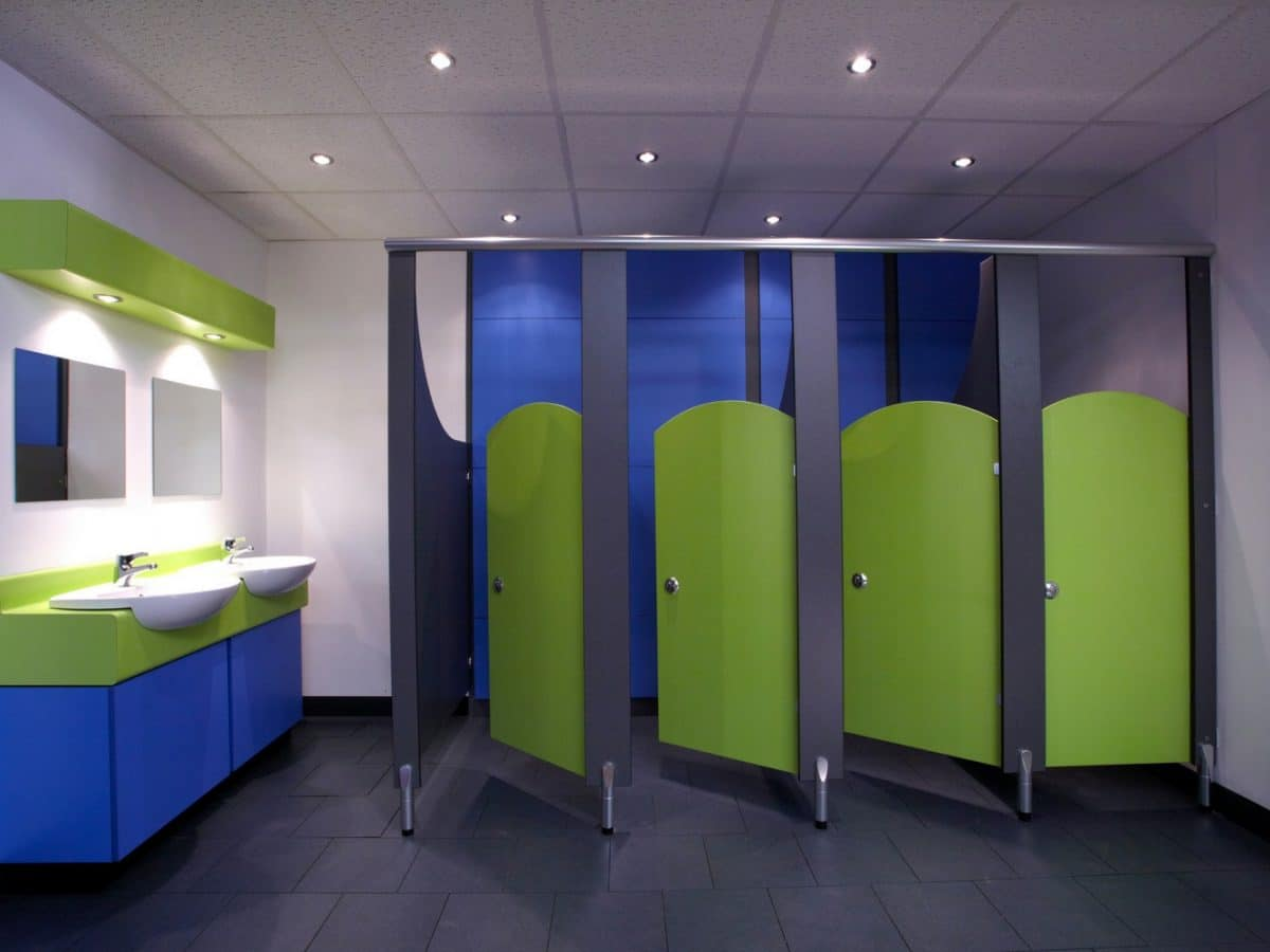 primary school toilet cubicle doors in green with blue panels
