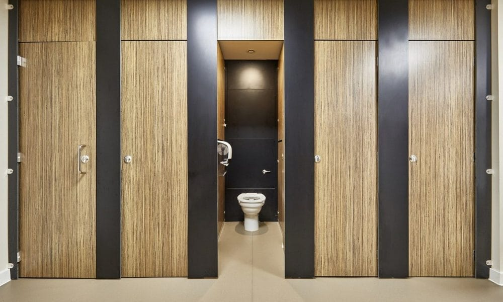 Altitude Education light wood toilet cubicles one open