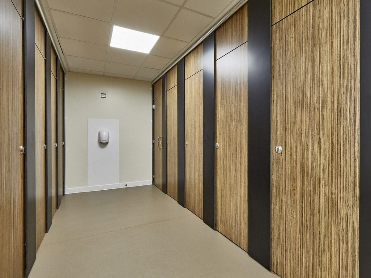 Altitude Education light wood toilet cubicles closed