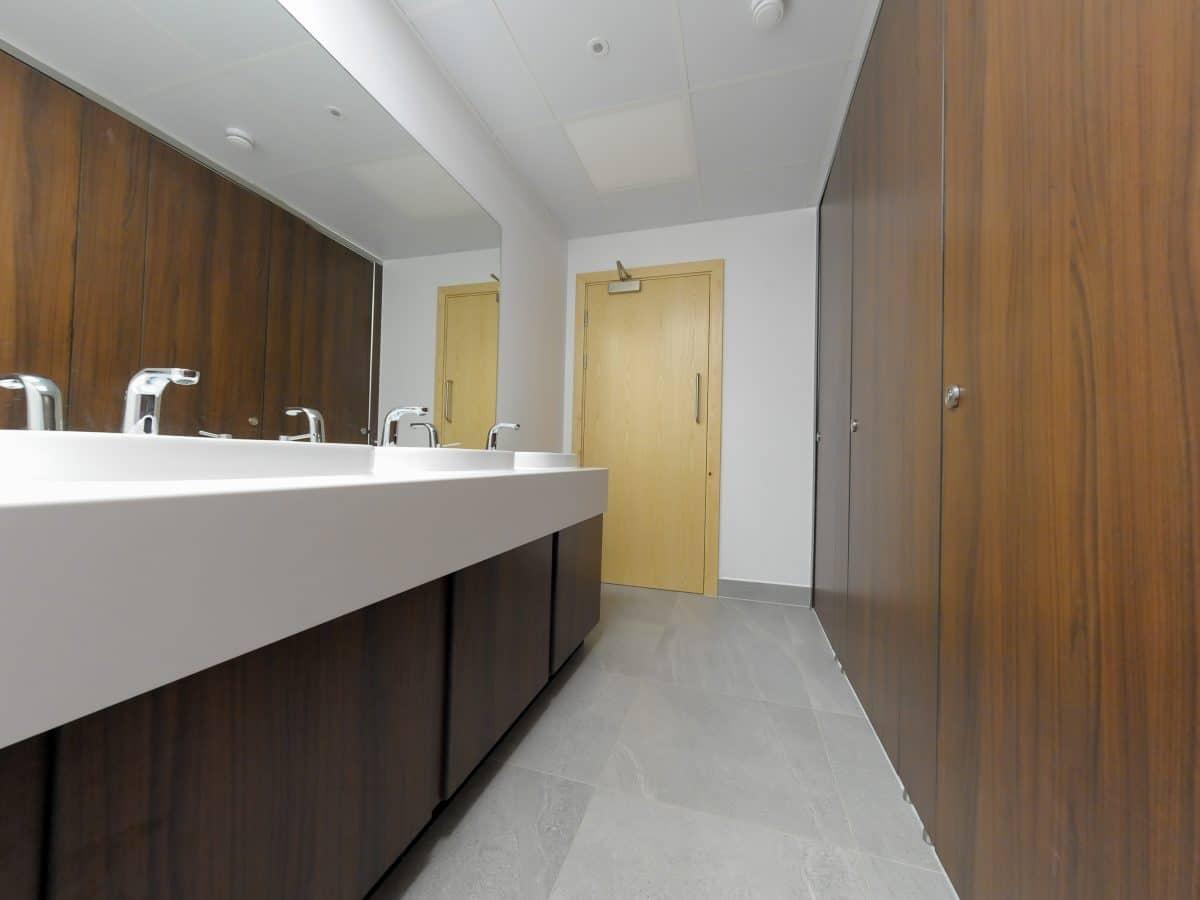 Altitude dark wood toilet cubicles ashford