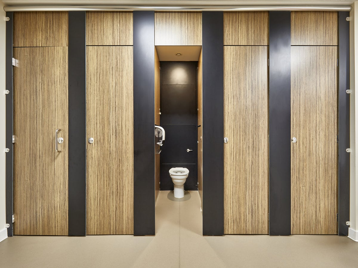 floor to ceiling school toilet cubicle with wood grain finish