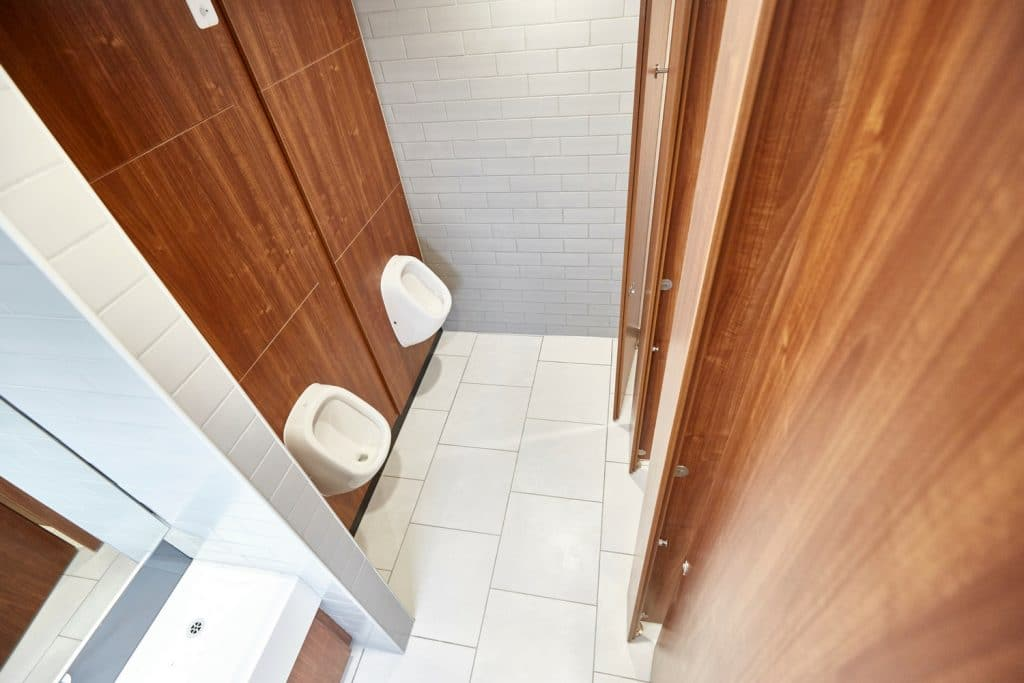 wood grain finish toilet cubicle doors in high end office