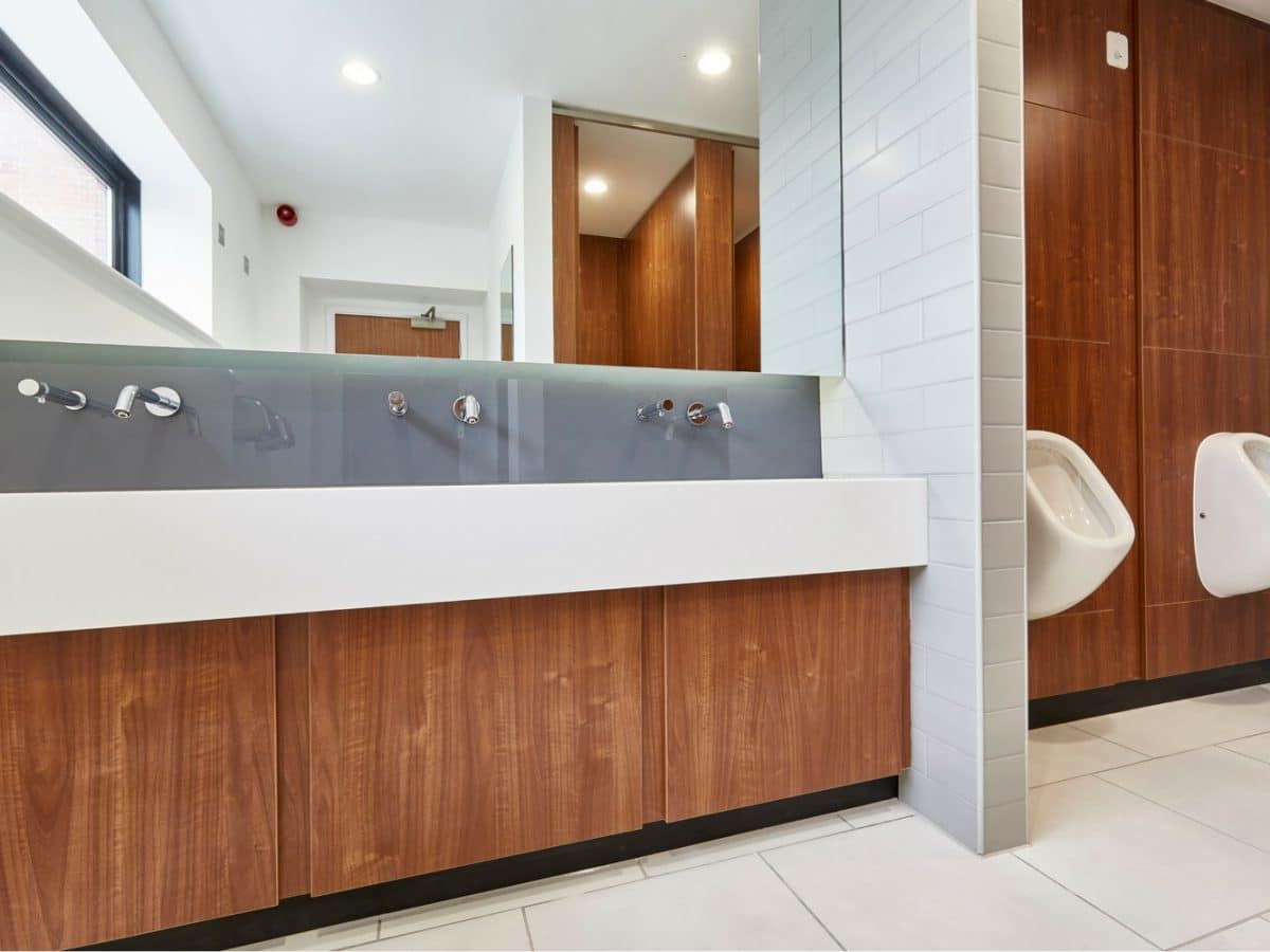 hand wash trough and wood finish washroom duct panels