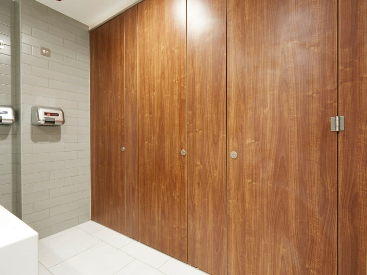 floor to ceiling wood grain toilet cubicle doors