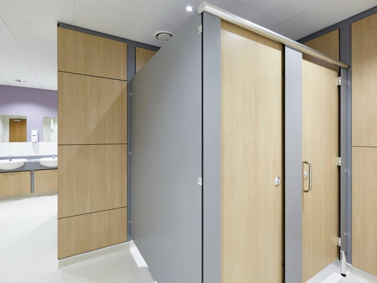 wood finish on toilet cubicle doors in commercial washroom