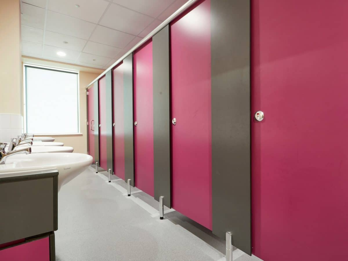 pink toilet cubicle doors in primary school