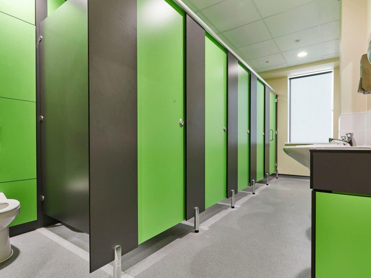 green toilet cubicle door in primary school toilet design