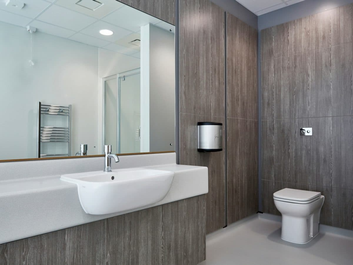 modern wood grain finish in commercial washroom design