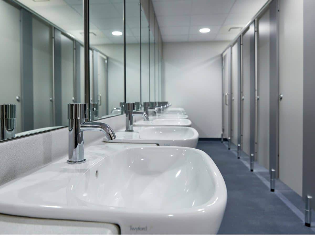 hand wash area and toilet cubicle system in grey