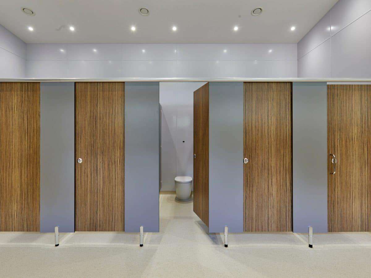 campsite toilet cubicle doors in natural wood grain finish