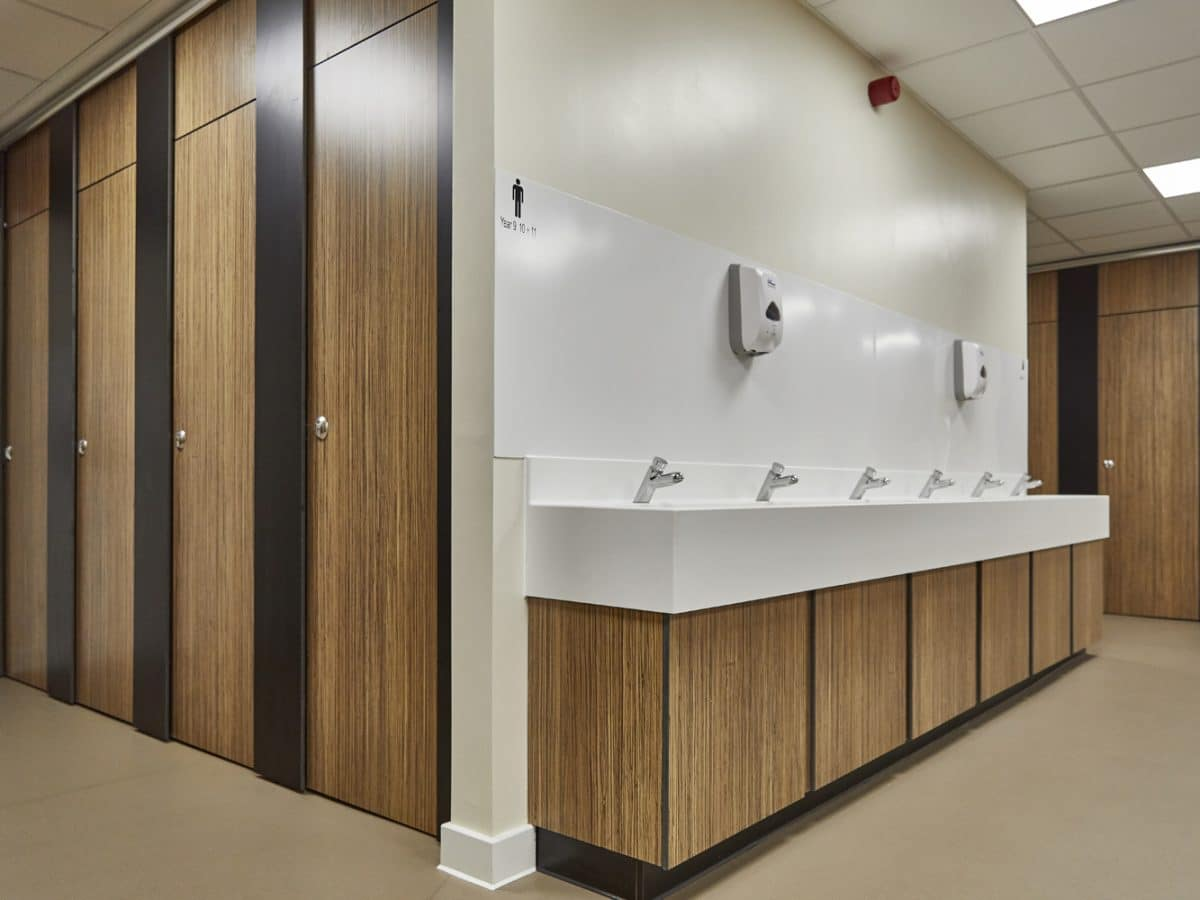 corian hand wash trough and full length school toilet cubicles