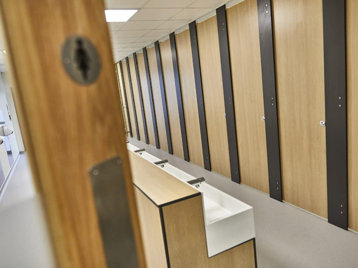 corian handwash trough and full height toilet cubicles