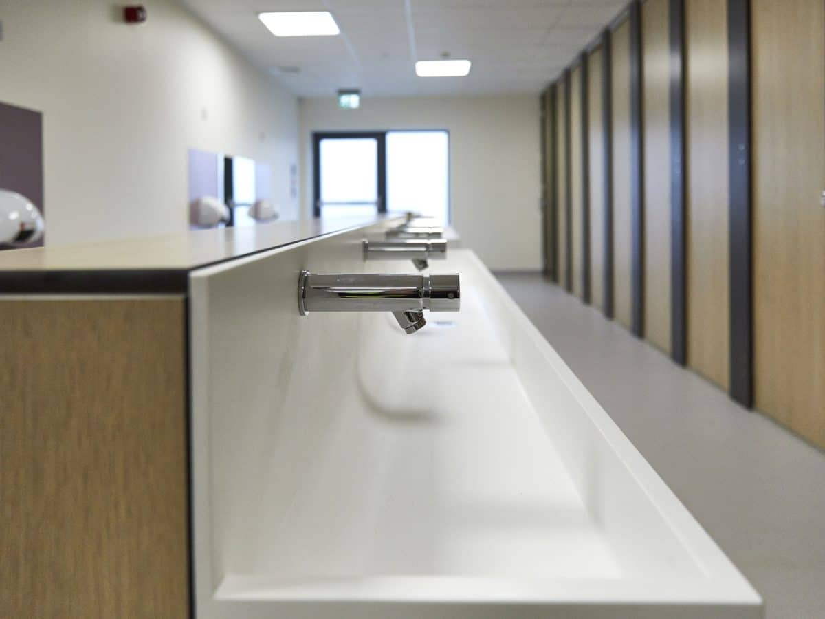 corian handwash trough in primary school toilet