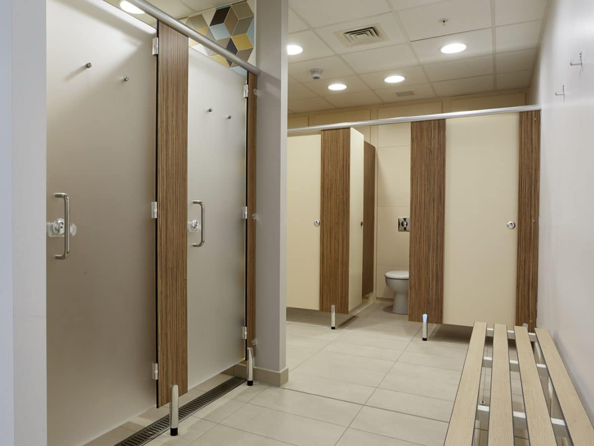 Global Food Producer Toilet Cubicles grey and wood close up