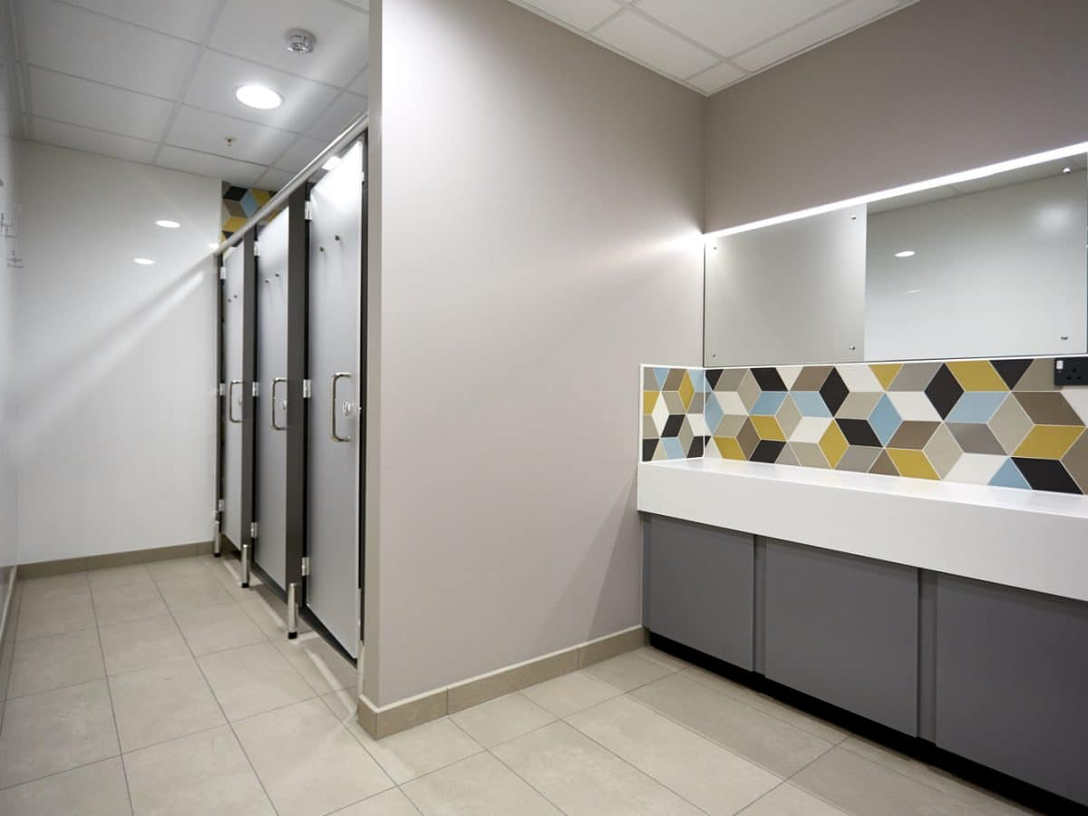 Global Food Producer Toilet Cubicles and trough basin