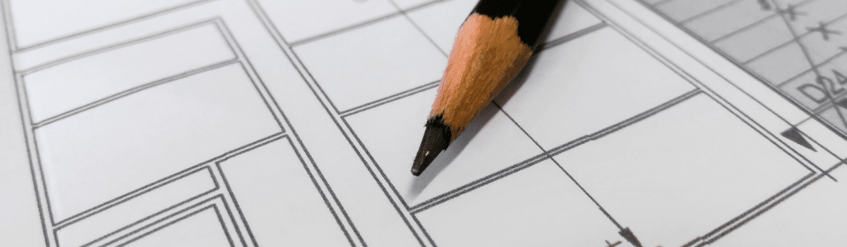 pencil lying on architectural drawing